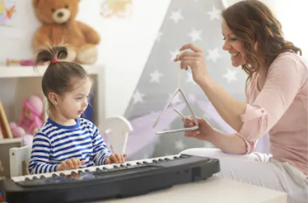 Parents helping children learn piano